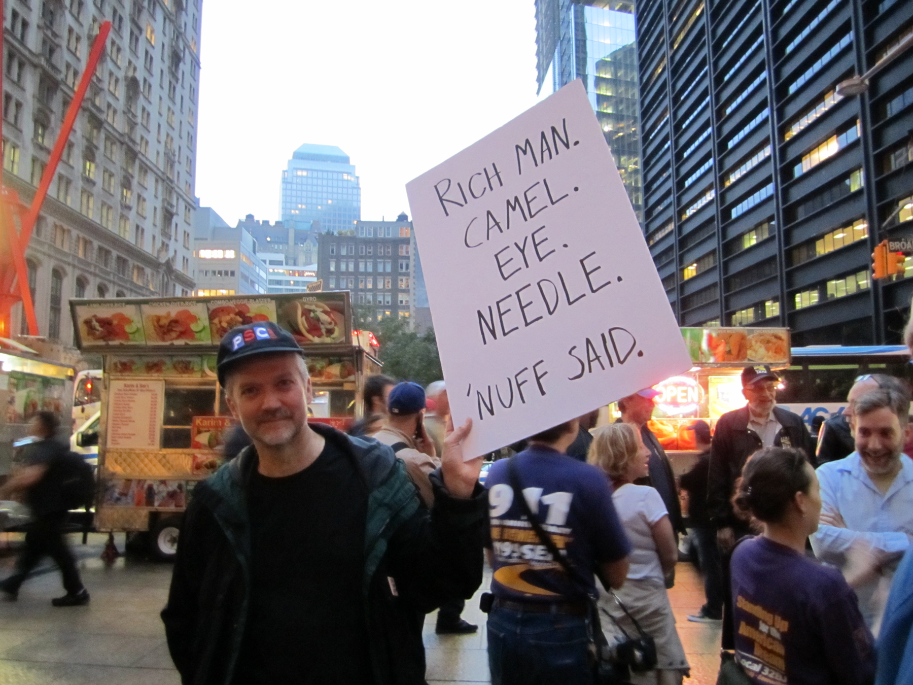 Oct 14 Rich man sign - Peter Hogness - by Amanda Magalhaes.jpg